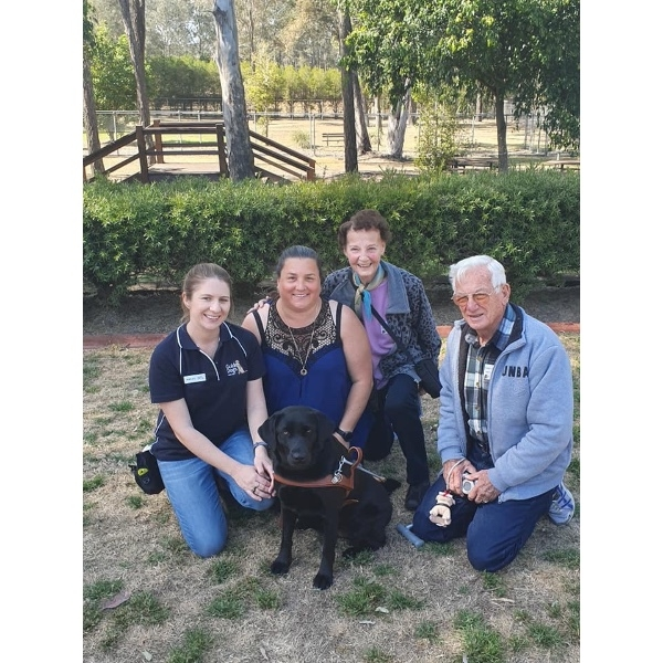 Luna with her trainer Haylee, Foster mum/puppy raiser Karen and home borders Aria & Rees.