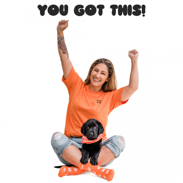 Image of girl sitting on ground with hands up in the air celebrating, she is wearing PAWGUST socks. A black puppy sits in her lap wearing a PAWGUST bandana. Copy on image says: You got this!